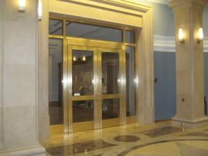 Brass clad door frames